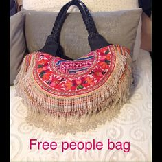 """Free People embroidered tassel beaded bag Incredible vintage fabric with genuine leather braided handles.  Shape is a hash moon. Adorned with beaded tassel fringe throughout the bottom of the bag.  Simply beautiful.     Bought as a one of a kind at Fee People few years ago.   Retail was $495. Will put up more photos.  Perfect condition no trades    Gorgeous intricate    20""""x9"""" x 5.5"""". Price negotiable. Free People Bags Hobos"""