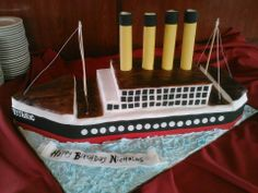 - * Titanic Cake, 4 layers of sheet cake stacked and carved.