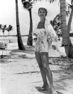 "This woman might be the Miami-based model named Elnita. The biographical information is unclear. However, the description of the photo clearly states that the swimsuit - manufactured by Alix of Miami - is inspired by France and the ""Far East."" The photo was taken on a Dade County beach called Matheson Hammock in 1959. Personally, I'd LOVE to have this swimsuit now - the ""Far East"" inspiration, notwithstanding."