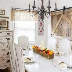 Learn how to build a sliding barn door (complete with a pet door! Using repurposed wood from an old farm building, this DIY project instantly adds rustic charm to any home! Painted Kitchen Tables, Kitchen Paint, Kitchen Buffet, Paint Furniture, Furniture Projects, Wood Projects, Sewing Projects, Furniture Design, Repurposed Wood