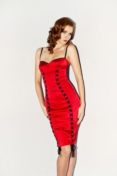 Channel the sophistication and sex appeal of a 1960s film starlet in the La Dolce Vita Bra Dress. Slinky and shapely deluxe stretch satin in our world famous Bra Dress cut with panel details for added va va voom. La Dolce Vita Bra Dress features petite sheer ruffle trim along bra cup edge, adjustable bra straps and amazing eyelet and plush velvet ribbon lace up detail. #NicheFashion