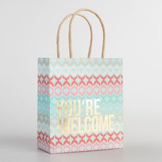 "Our exclusive kraft paper gift bags feature geometric designs, warm colors and gold foil lettering. You won't have to say ""you're welcome"" with…"