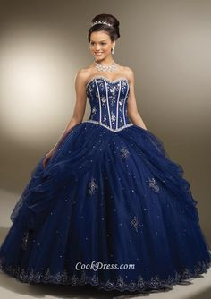 Navy blue strapless ball gown quinceanera dress for special event. Beaded sweetheart neckline with bonings on corset bodice, ball gown skirt with slit ruffles overlay finishes off the look, lace up back.  <br><br>Matching bolero jacket.  <br><br>