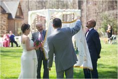 a romantic first-look incorporating some indian wedding customs where a white sheet is held in front of the groom to prevent him from seeing his bride approaching - multicultural first look photography - Lea & Rupal - #firstlook #springweddings #southernweddings - southern wedding photographers, raleigh nc