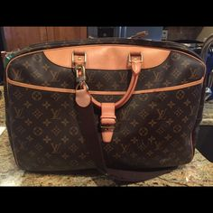 Authentic LV travel bag. This bag is a cross between the Caryall and the Hunting Bag. They don't make it anymore. Great carry on or weekend bag. Louis Vuitton Bags Travel Bags