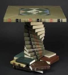 Clever idea for old books, especially encyclopedias. Turn them into a board game table! Item created by Jim Rosenau. (Source: Greenopolis : This Into That - Recycling Old Books into -Crafted Book Furniture! )