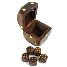 Handmade gift from India, this hinged box designed as a die and carved from sheesham wood contains five dice, each with inlaid brass pips. The box is 2 inches square. Only 14.99!