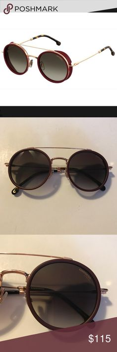 Carrera Sunglasses New. Never worn. Perfect condition. Were on display at an optometrist's office.  Name: Carrera 167/S. Color: DDBHA.  Bordeaux frame with gold hardware & fashionable grey gradient lenses.  Can hold prescription lenses.   Comes with case & microfiber cleaning cloth.   *** Can pick a Free With Purchase item ***  Please ask if any questions. Carrera Accessories Sunglasses