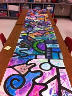 Collaborative watercolor art project (special ed). Teacher preps by doing big black lines, kids come in to add crayon details in their groups, they finish by painting over the crayon designs with watercolors.