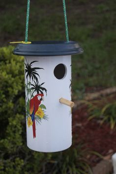 Birdfeeder made from pvc pipe and a clay pot bottom.