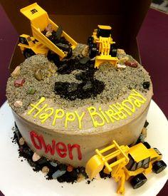 Construction site birthday cake with chocolate rocks, Oreo dirt & lots of trucks!