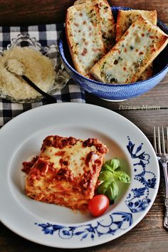 Lasagna Bolognese - This homemade authentic Italian dish is made with delicate layers of pasta and slow simmered sauce for an amazing lasagna.