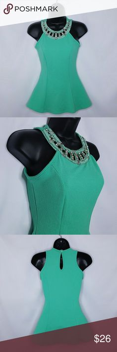 Teal Pelum Top with Rhinestone Accents Gorgeous teal colored pelum top in great condition with a beautiful rhinestone accents collar. klaxoms Tops Blouses