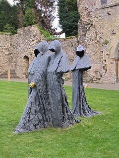 Beaulieu Abbey, Hampshire, England, UK - Sculpture of hooded monks