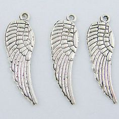 Small Silver Angel Wing Charms 8 by CloudNineSupplyShop on Etsy, $2.00