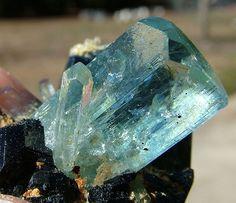 Aquamarine crystal on tourmaline