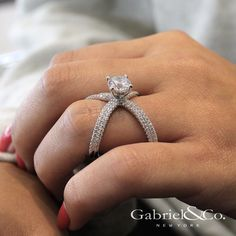 Gabriel & Co. - Voted #1 Most Preferred Bridal Brand.   Show your special love with this extraordinary round diamond engagement ring featuring a diamond-studded split shank band.