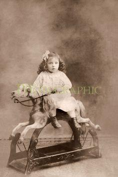 Cute little girl on an antique rocking horse