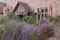 If I wasn't a lady, I would use a four letter word to express my dismay that I am not sitting in front of this gorgeous....Cotswold cottage