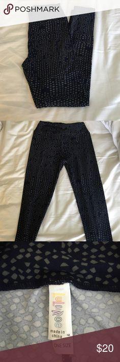 LuLaRoe leggings NWT never been worn dark navy blue with grey pattern. Super cute with a grey top! LuLaRoe Pants Leggings