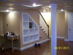 Cherry floors, built in cubbies, drop ceiling... wonder if cubbies would work on the basement stairs... each kid gets a cubby?