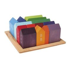 Love these but they are way too expensive. Maybe I could find some unpainted blocks and paint them. Small Wooden Blocks Village from Grimm%27s Toys