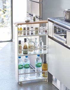 Rolling cart: keep this three-tiered slim storage cart stocked with oils, spices, or anything you need close by while cooking. The wheels on the base make it easy to pull out for use and stow away again when finished. The item is tall and slim and therefore fits perfectly in narrow spaces that can't be used otherwise Small Kitchen Cabinet Design, Small Kitchen Storage, Kitchen Cabinet Remodel, Kitchen Cabinet Storage, Modern Kitchen Cabinets, Kitchen Layout, Diy Kitchen, Kitchen Decor, Small Apartment Storage
