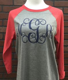 Large Monogram Raglan Tee You will LOVE our large vine monogram raglan tee! The raglan baseball-look tee is a bella + canvas brand made of combed ringspun cotton and polyester, so it is super soft! It