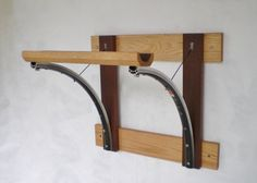 Bicycle wall rack constructed of wheel rims and reclaimed wood.