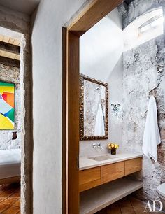 The sink in the master bathroom is cast concrete | archdigest.com