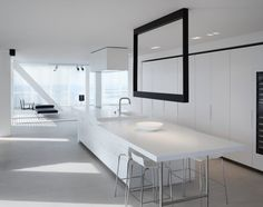 Penthouse Rotterdam. Black rectangular structure accommodates LEDs functions as minimalistic chandelier.