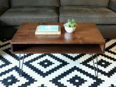 Make coffee table out of ply and dark stain Sam can make legs for it or buy the angled legs