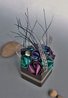 Paua wedding centrepiece in a ceramic cube. These make great wedding favors to give away at the end of the wedding day.  www.flaxation.co.nz