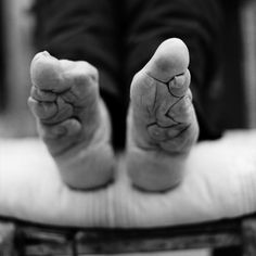 After soaking in warm herbs and animal blood, the toes would be curled over to the sole of the foot and bound with cotton bandages.