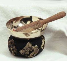 """Large Seven Metal Tibetan Singing Bowl Set With Striker and Pillow by Tibetan Singing Bowls. $64.95. 4.75"""" diameter bowl with puja stick, pillow, and information card.A singing bowl is a type of bell shaped as a bowl. They come in many shapes and sizes, and are made using seven metals, which are copper, tin, lead, iron, zinc, silver, and gold. Singing bowls were traditionally made throughout Asia. The tradition continues today in Nepal, India, China, and Japan."""