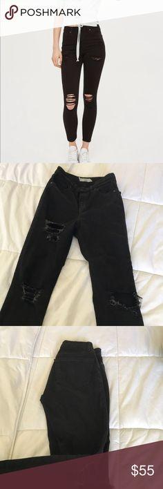 Black Jamie high waist distressed jeans size25 Black Jamie high waist distressed jeans from Topshop size 25 waist 32 Length. Topshop Jeans Skinny
