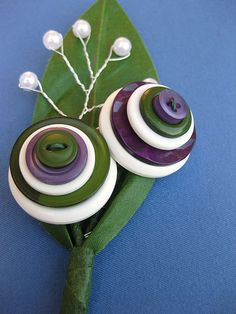 boutonniere, this is adorable I love it. If I can have variations of green and blue.