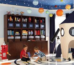 outer space room- like the planets on the ceiling; robots on the shelves; little rocket play area- fun room!
