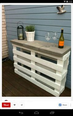 Pallet bar. Nice side table for outside entertaining.