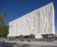 Location: Madrid, Spain  Architect: dosmasuno arquitectos | Ignacio Borrego, Néstor Montenegro and Lina Toro  Developer: EMVS. Empresa Municipal de la Vivienda y Suelo de Madrid  Programme: 52 single dwellings, 35 double dwellings, 15 triple dwellings + 104 parking slots + commercial space  Site area: 4446.15 m2  Built area: 12277.15 m2  Total floor area: 8382.15 m2  Stories: 7 (6 + basement)  Structure*: Reinforced concrete (core) + Light steel structure (additions)  Finish*: white…