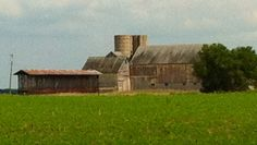 Old corn crib and beautiful old barn in Clinton County, Ohio. I don't see many of these old style corn cribs anymore. Brings back memories of younger years!