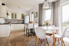Light stylish interior with round table, white chairs and functional open kitchen Stock Photo , Flooring Store, Vinyl Flooring, Living Room Furniture, Living Room Decor, Types Of Curtains, Location Meublée, Thermal Curtains, Blackout Curtains, Luxury Living