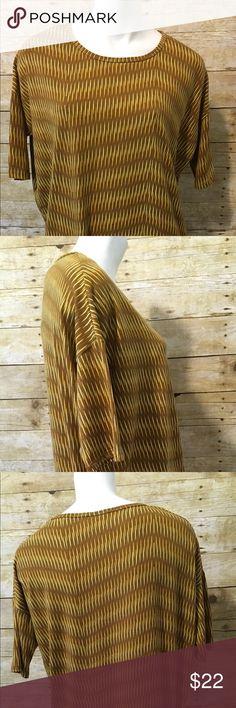 "Lularoe Mustard Yellow Printed Irma Shirt Lularoe Mustard Yellow Printed Irma Shirt. Women's Size XSmall. The Sleeves look skinny. 96% Spun Polyester, 4% Spandex. Chest Measurements 25"". LuLaRoe Tops"