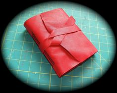 Red Leather Wrap Journal -. $25,00, via Etsy. - 70 pound heavy artist paper with a medium tooth - 144 pages counted double sided - 4.5 x 6.5 inches - Quality heavy Leather - Sewn with heavy waxed thread 20€ + FDP