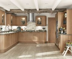 This light oak wooden style kitchen is from our Fairford range, part of the Howdens Shaker Kitchen Collection. It gives a lovely traditional, warm feel to your kitchen. Shaker Style Kitchens, Shaker Kitchen, Kitchen Units, New Kitchen, Kitchen Decor, Oak Kitchens, Kitchen Ideas, Kitchen Living, Living Room
