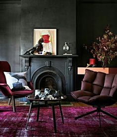Using pink in masculine ways paired with textured charcoal walls. Love quilted swivel chair.