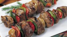 For a real grilling treat, try our Filet Mignon Kabobs. Bite-size chunks of Filet Mignon with mushroom caps, and green and red peppers are a tantalizing change of pace. Our Shish Kabobs are elegant and easy to fix too! Kabob Recipes, Grilling Recipes, Beef Recipes, Cooking Recipes, Beef Shish Kabob, Beef Kabobs, Kebabs, Fruit Kabobs, Omaha Steaks