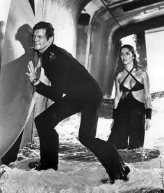 The Spy Who Loved Me (1977): James Bond (Roger Moore) vs Jaws (Richard Kiel). Description from pinterest.com. I searched for this on bing.com/images