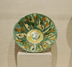 Bowl with Splash Motif, 10th century. Ceramic; earthenware, painted in splashes of black, brown, green, and yellow pigments on an incised white slip ground under a transparent glaze, 2 3/4 x 9 13/16 in. (7 x 25 cm). Brooklyn Museum, Gift of Alastair B. Martin, 72.86.2. Creative Commons-BY (Photo: Brooklyn Museum, CUR.72.86.2.jpg)