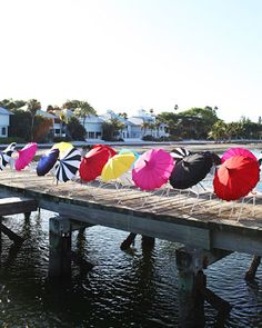 Guests were given vibrant parasols to shade themselves during this waterfront ceremony
